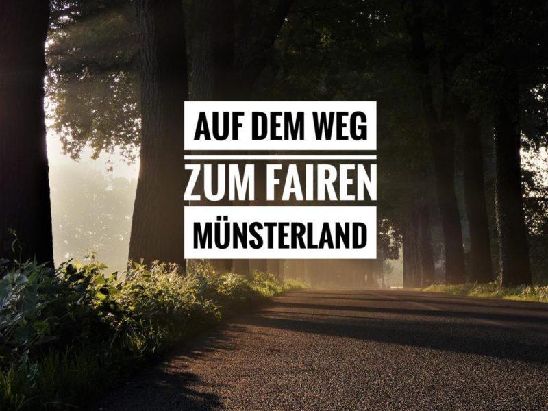 Baumallee mit der Beschriftung: Auf dem Weg zum fairen Münsterland